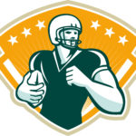Illustration of an american football gridiron runningback player running with ball set inside crest shield done in retro style.
